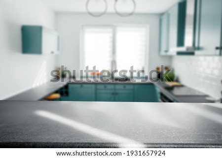 Blurred modern kitchen interior and desk space and outstanding furniture.  Royalty-Free Stock Photo #1931657924