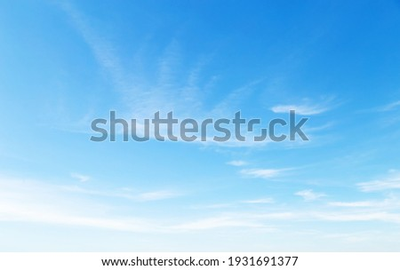 blue sky with puffy clouds background Royalty-Free Stock Photo #1931691377