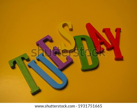 Picture an alphabetic arrangement showing the word Tuesday.