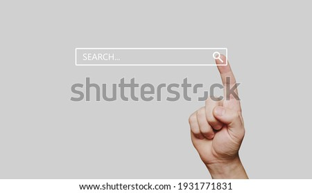 Search bar internet data browser. Man hand presses the information search button on computer touch screen,copy space.