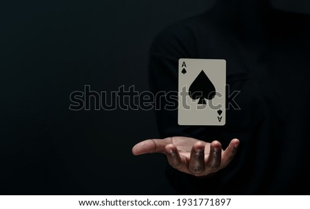 Ace Spade Playing Card. Levitating Poker Card on Hand. Front View. Closeup and Dark Tone Royalty-Free Stock Photo #1931771897