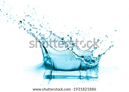 turquoise water splash, isolated on white Royalty-Free Stock Photo #1931821886