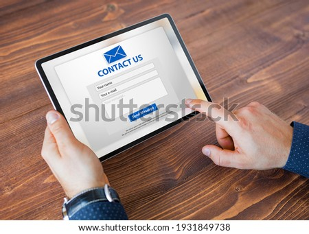 Man submitting contact form on website Royalty-Free Stock Photo #1931849738