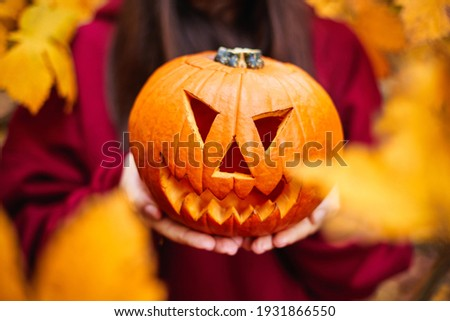 Jack-o'-lantern carved pumpkin. Halloween pumpkin with ghoulish face. Autumn colors. Royalty-Free Stock Photo #1931866550