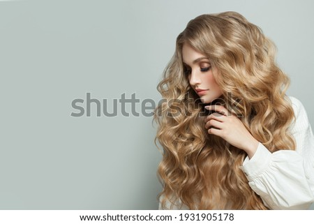 Nice woman with long healthy blonde hair on white banner background Royalty-Free Stock Photo #1931905178