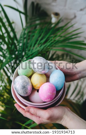 These images contain pictures of colored eggs in a basket