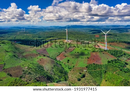 Wind generator - wind farm at Ea hleo, Dak Lak, Vietnam. Modern equipment for generating electric energy. The concept of environmental friendliness, environmental protection and tourism photo