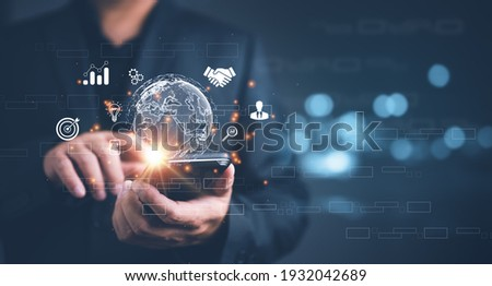 Businessman using mobile smart phone. Business global internet connection application technology and digital marketing, Financial and banking, Digital link tech, big data. Royalty-Free Stock Photo #1932042689
