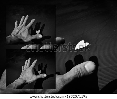 freestyle art photo,Hand try to hold a heart on black background . broken heart
