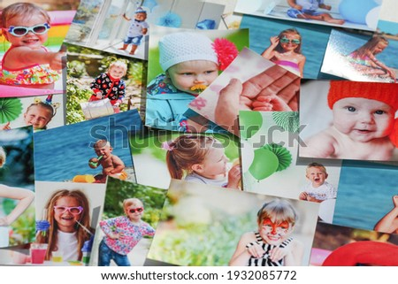 Printed photographs of children. A huge amount of printed materials. Royalty-Free Stock Photo #1932085772