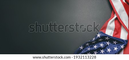 USA flag on dark background with space for text