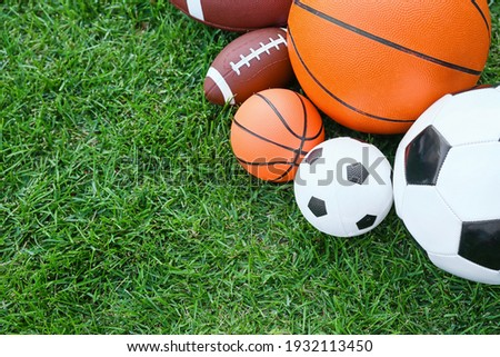 Set of sport equipment on green grass Royalty-Free Stock Photo #1932113450