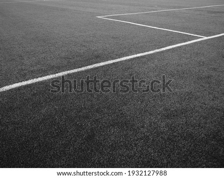 The marking of the football field. White lines no more than 12 cm or 5 inches wide. Football field area. Black and white monochrome photography. Royalty-Free Stock Photo #1932127988