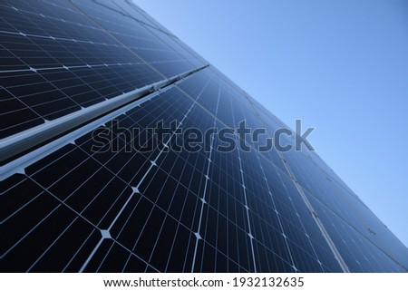 Solar panels against blue sky background.Against The Deep Blue Sky in a suny weather Royalty-Free Stock Photo #1932132635