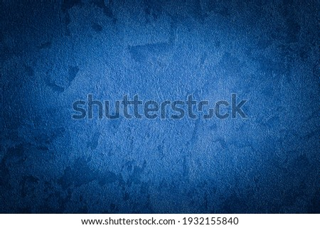 Blue decorative plaster texture with vignette. Abstract grunge background with copy space for design. Royalty-Free Stock Photo #1932155840