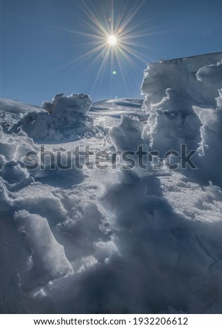 Melting ice and snow, mountain landscape with blue sky and bright sun