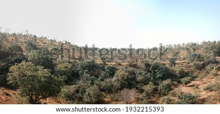 Dry hills and scrub (evergreen sclerophyllous bush formation) in the area of the Deccan plateau, India Royalty-Free Stock Photo #1932215393
