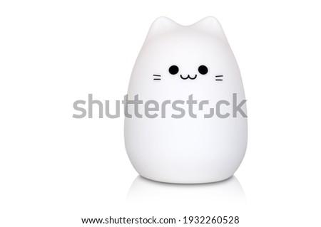 white cat shaped night lamp isolated on white