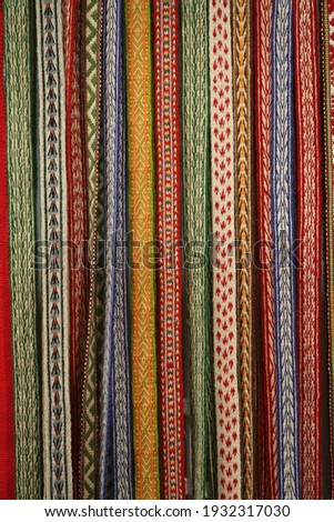 Woven belts in traditional national folk russian style. Ethnic pattern. Russian ornament. Ornamental russian handmade woven belts. Needlework. Homemade woven belts. Textile in national russian style Royalty-Free Stock Photo #1932317030