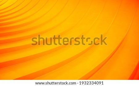 Abstract curved lines. Orange geometric background Royalty-Free Stock Photo #1932334091