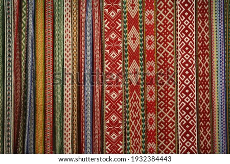 Woven belts in traditional national folk russian style. Ethnic pattern. Russian ornament. Ornamental russian handmade woven belts. Needlework. Homemade woven belts. Textile in national russian style Royalty-Free Stock Photo #1932384443