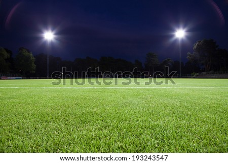 soccer field with spot lights (background) Royalty-Free Stock Photo #193243547