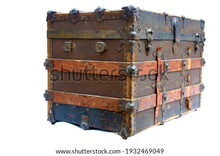 Steamer Trunk.Antique Steamer Trunk. Isolated on white. Steamer Trunks have been used as luggage for years to protect and move clothes and items while traveling the country or the world. Royalty-Free Stock Photo #1932469049