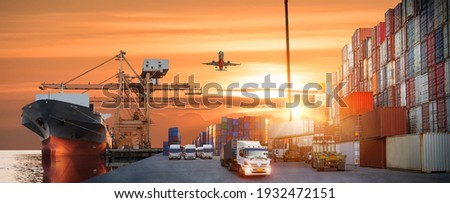 Container truck in ship port for business Logistics and transportation of Container Cargo ship and Cargo plane with working crane bridge in shipyard at sunrise, logistic import export Concept Royalty-Free Stock Photo #1932472151