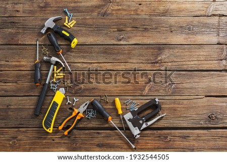 set of repair tools on old wooden background Royalty-Free Stock Photo #1932544505