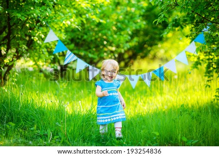beautiful little girl blue dress on the nature #193254836