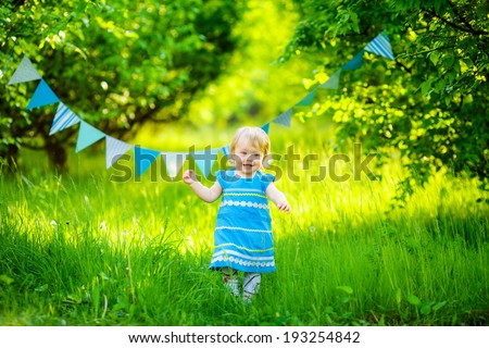 beautiful little girl blue dress on the nature #193254842