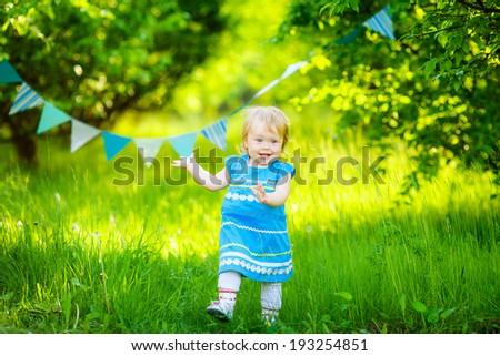 beautiful little girl blue dress on the nature #193254851