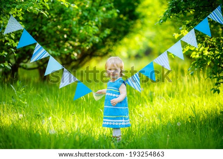 beautiful little girl blue dress on the nature #193254863