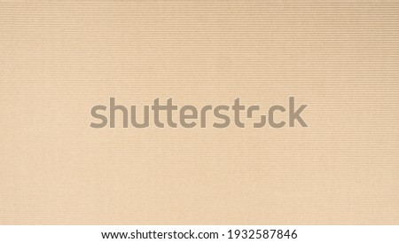 Abstract brown recycled paper vertical lined texture background. Old Kraft box craft paper stripes pattern seamless. top view.