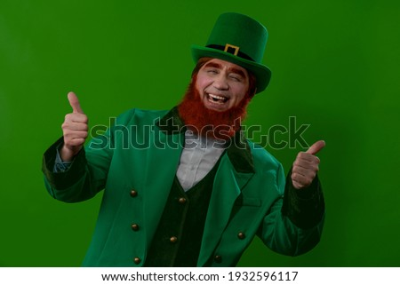 Male cheerful character Leprechaun laughing with thumbs up - a symbol of the Irish holiday of March 17 St. Patrick. Suitable for bar, pub party advertisements, for printing on calendars, postcards