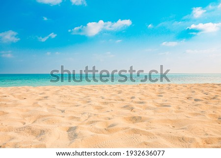 Closeup of sand on beach and blue summer sky. Panoramic beach landscape. Empty tropical beach and seascape. Orange and golden sunset sky, soft sand, calmness, tranquil relaxing sunlight, summer mood  Royalty-Free Stock Photo #1932636077