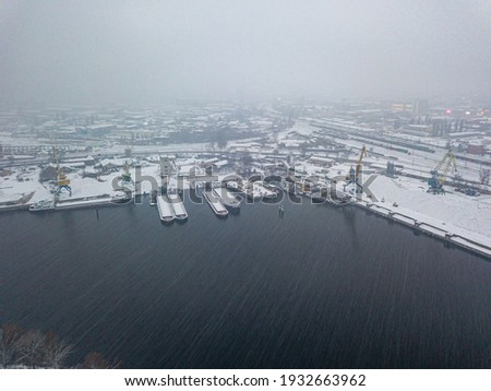 Blizzard in the industrial port. Snowy day, blizzard. Aerial drone view.