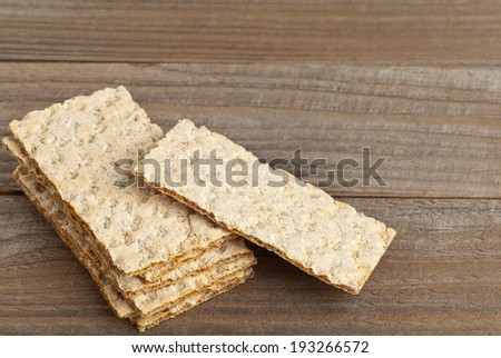 Multiple slices of wheat crispbread on wooden table #193266572