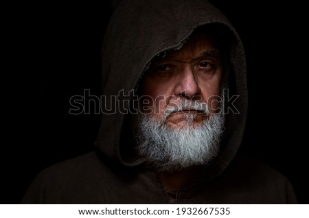 Medieval character face of a monk or Beggar Royalty-Free Stock Photo #1932667535