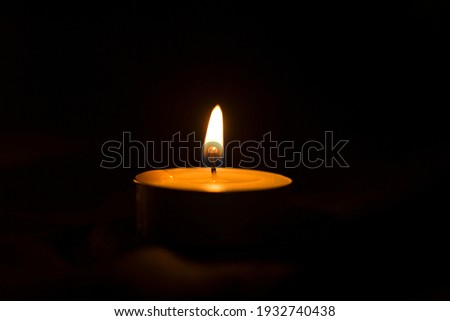 Lit candles for dinner in the dark, burning candles Royalty-Free Stock Photo #1932740438