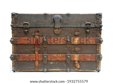 Steamer Trunk. Antique Steamer Trunk. Isolated on white. Vintage Shipping and Storage Trunk. Locking and Latching Old Trunk from the 1800's.  Royalty-Free Stock Photo #1932755579