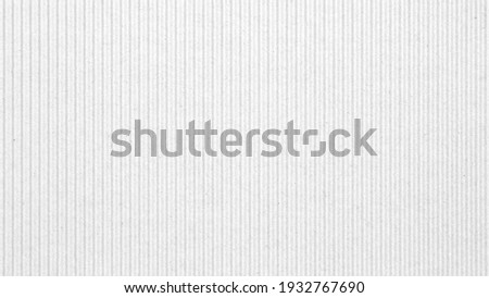 Abstract white recycled paper vertical lined texture background.  Old Kraft box craft paper stripes pattern seamless.  top view. Royalty-Free Stock Photo #1932767690