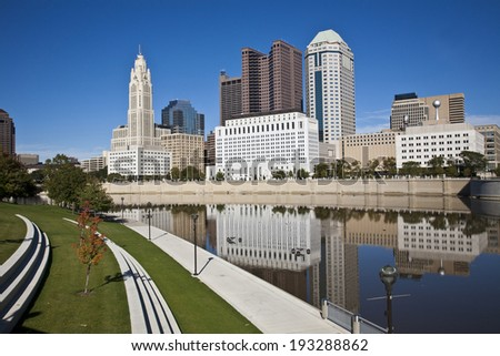 The Columbus, Ohio skyline reflected in the Scioto River.  Columbus is the capital of Ohio.