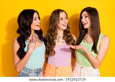 Photo of young happy smiling good mood best friends girl talking sharing news emotion isolated on yellow color background