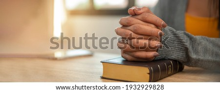 Prayer and bible concept. Hand of female praying, hope for peace and free, Hand in hand together by woman, believe and faith in christian religion at church-panoramic banner for web h