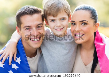 lovely american family with US flag outdoors on 4th of July #193297640