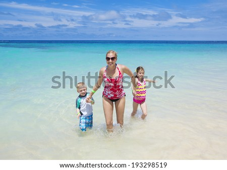 Family Enjoying a Beach vacation together #193298519