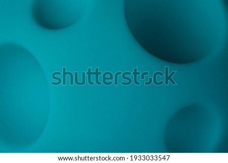 abstract background of cartoon blue planet, moon toy with craters