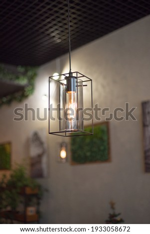 chandelier with a lamp in the loft style in the interior