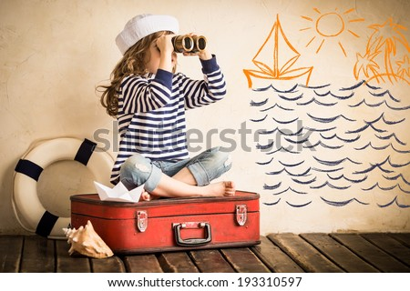 Happy kid playing with toy sailing boat indoors. Travel and adventure concept #193310597